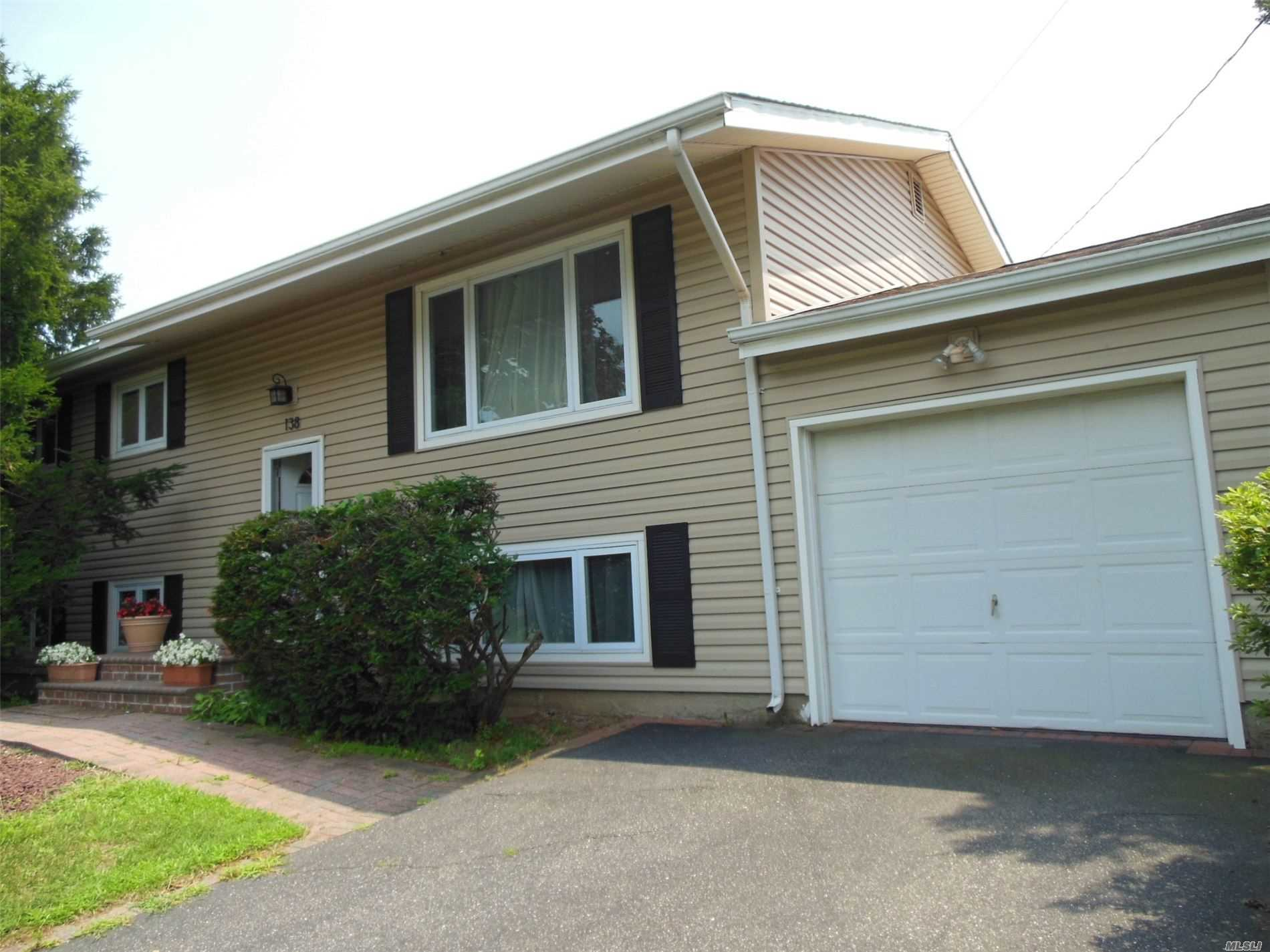 Residential For Sale in 138 Ridge Rd, Wheatley Heights, NY ,11798