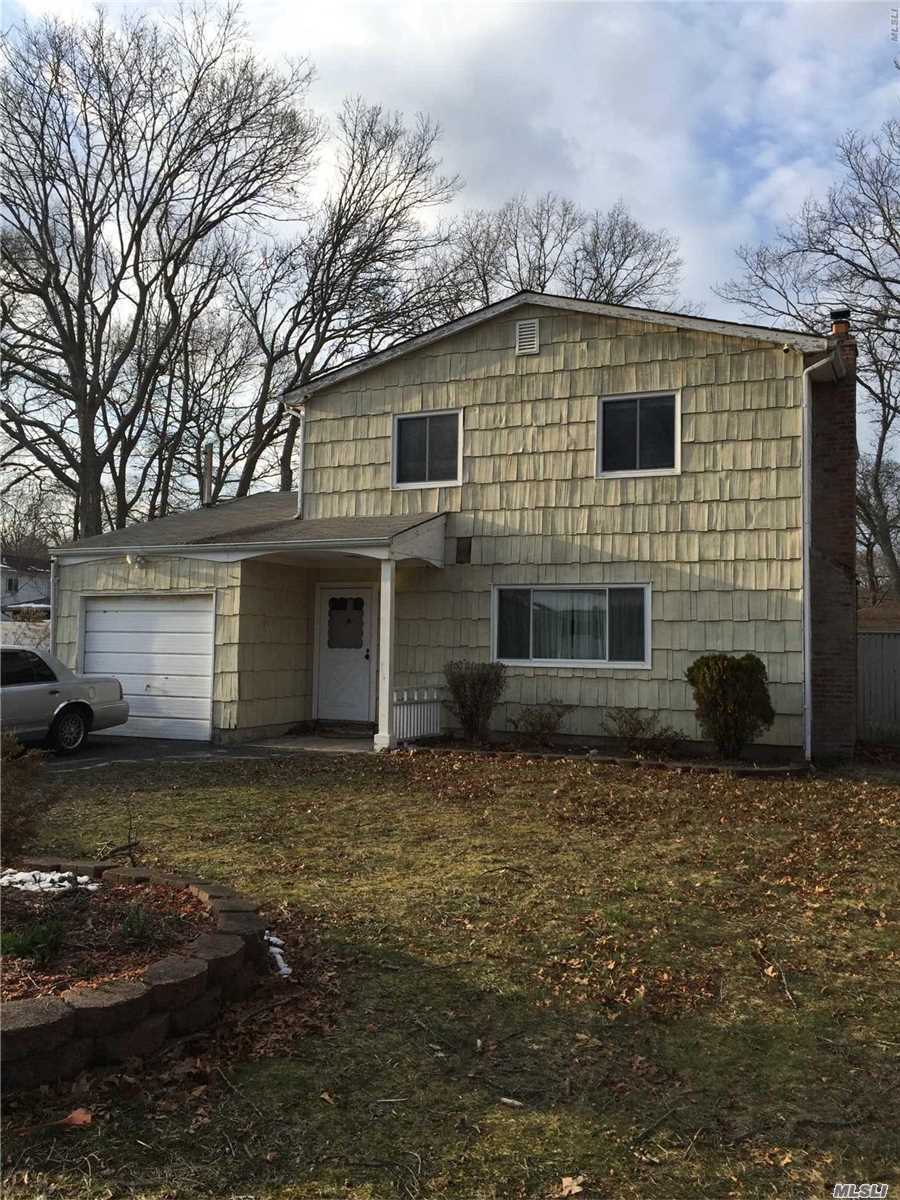Residential For Sale in 105 Shinnecock Ave, Mastic, NY ,11950