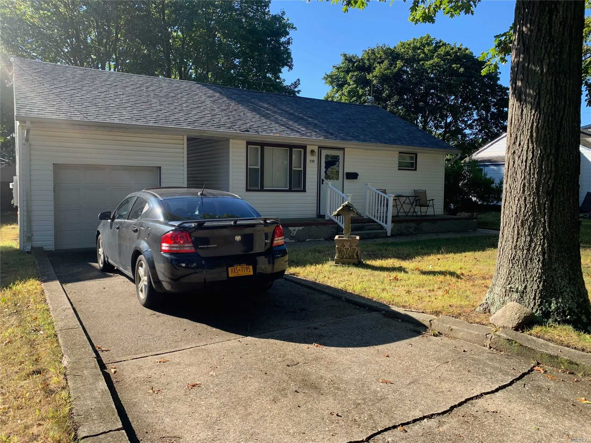 Residential For Sale in 330 Florida Ave, Copiague, NY ,11726