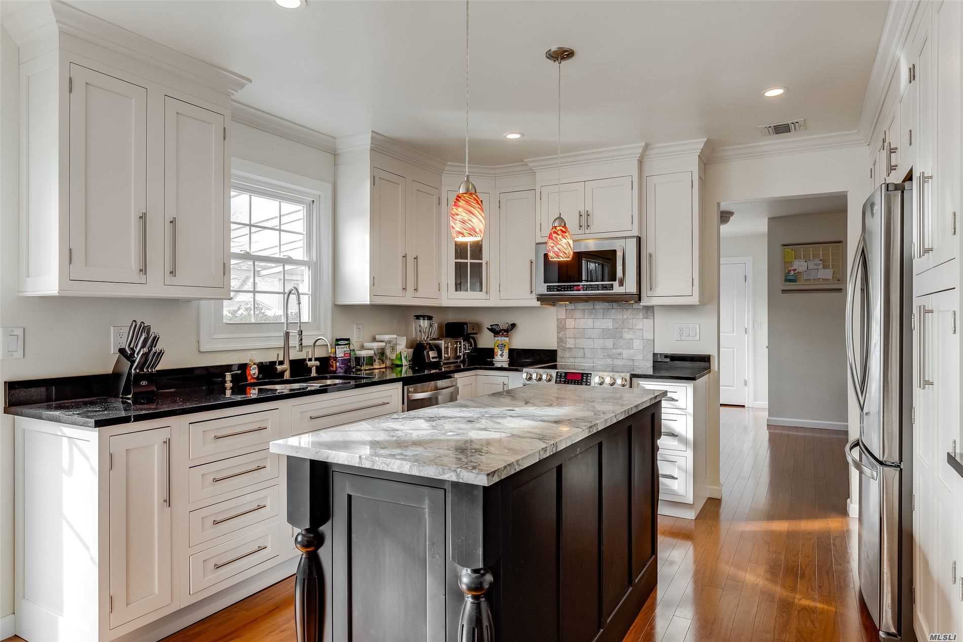 Residential For Sale in 307 Lagoon Drive W, Copiague, NY ,11726