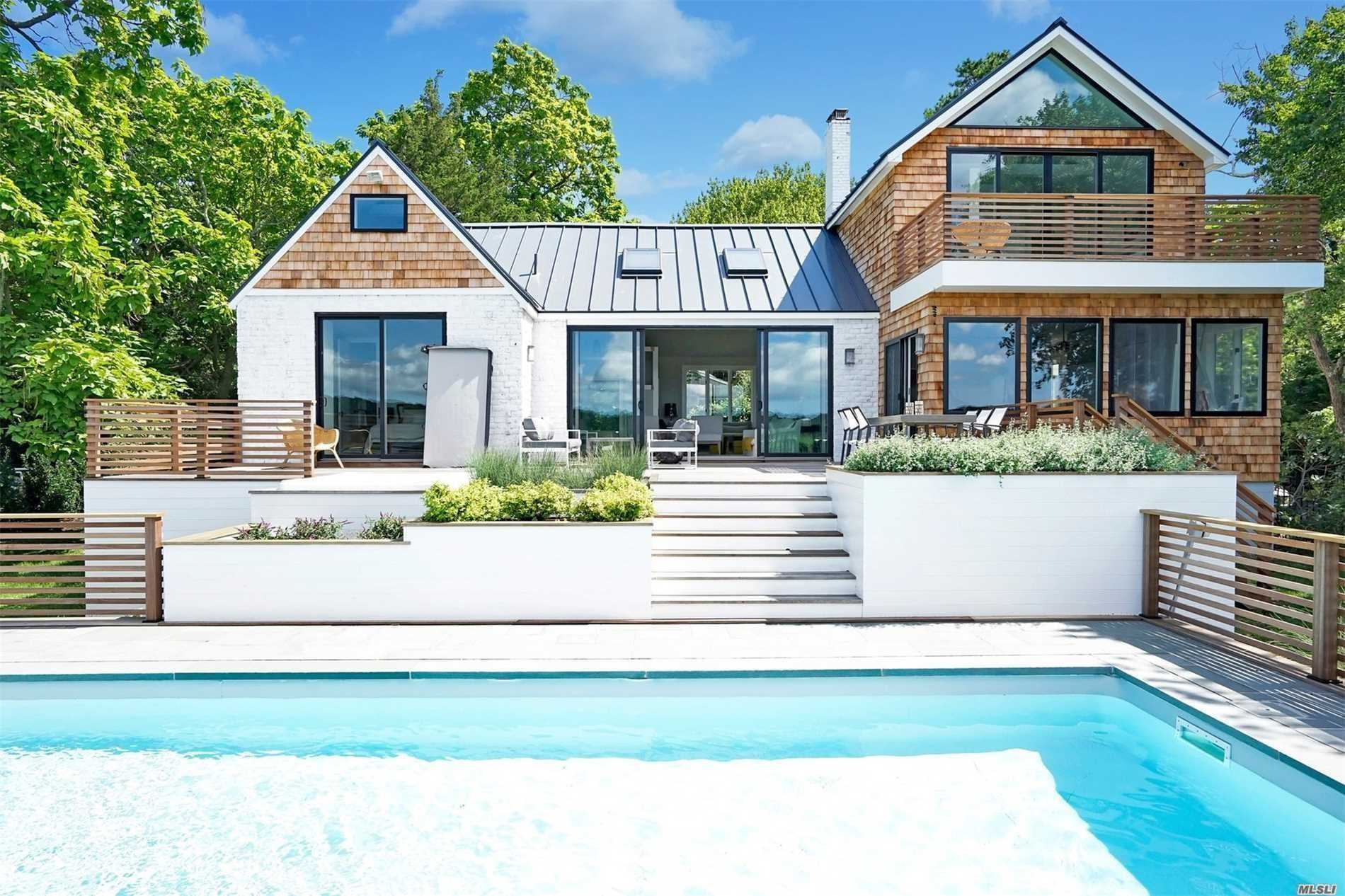 Residential For Sale in 26 Tiana E Rd, Hampton Bays, NY ,11946
